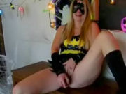 Batgirl masturbating, swallowing cum, and then having a screaming orgasm!