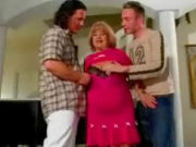 Two guys chatiing up Granny, she likes the two young cocks!