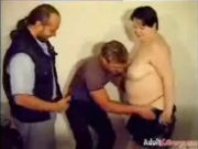 Two guys undressing and sharing a chubby gothic lady!