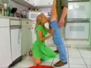 Housewive surprising the young neighbours guy in the kitchen