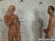 Hot MILF meets a guy in the showers at the gym, he is washing his cock, and she notices it gets stiff...