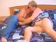 Granny grabs a young boy in his crouch to get his cock...
