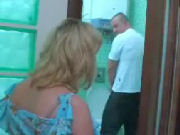 Naughty MOMMIE sneaking up on dude in toilet, he notices her and...