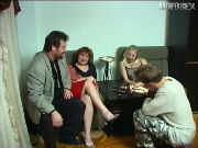 Mature swingers couple having sex with a young couple