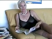 Mature woman reading pornmagazines in private video